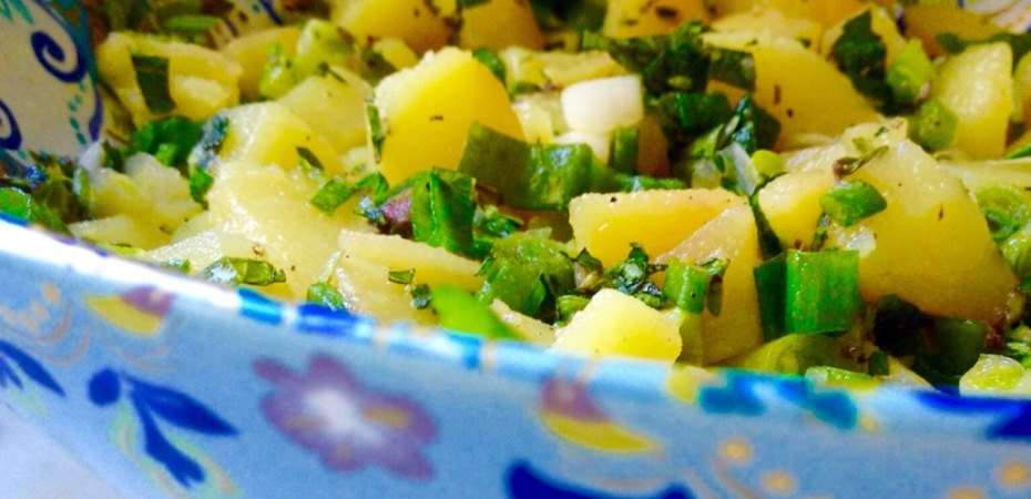 Parsley, green onion, olive oil, and lemon juice atop chopped potatoes
