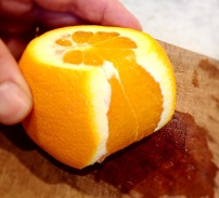 Trimming the peel and pith off the orange