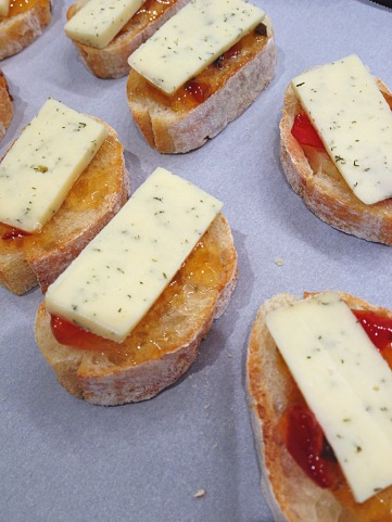Havarti cheese is put over the jelly on the baguette