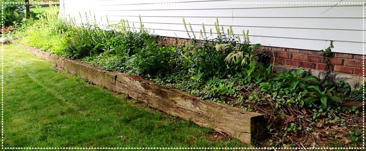 Railroad ties as edging along the house