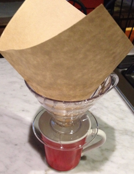 funnel over mug with rectangular filter