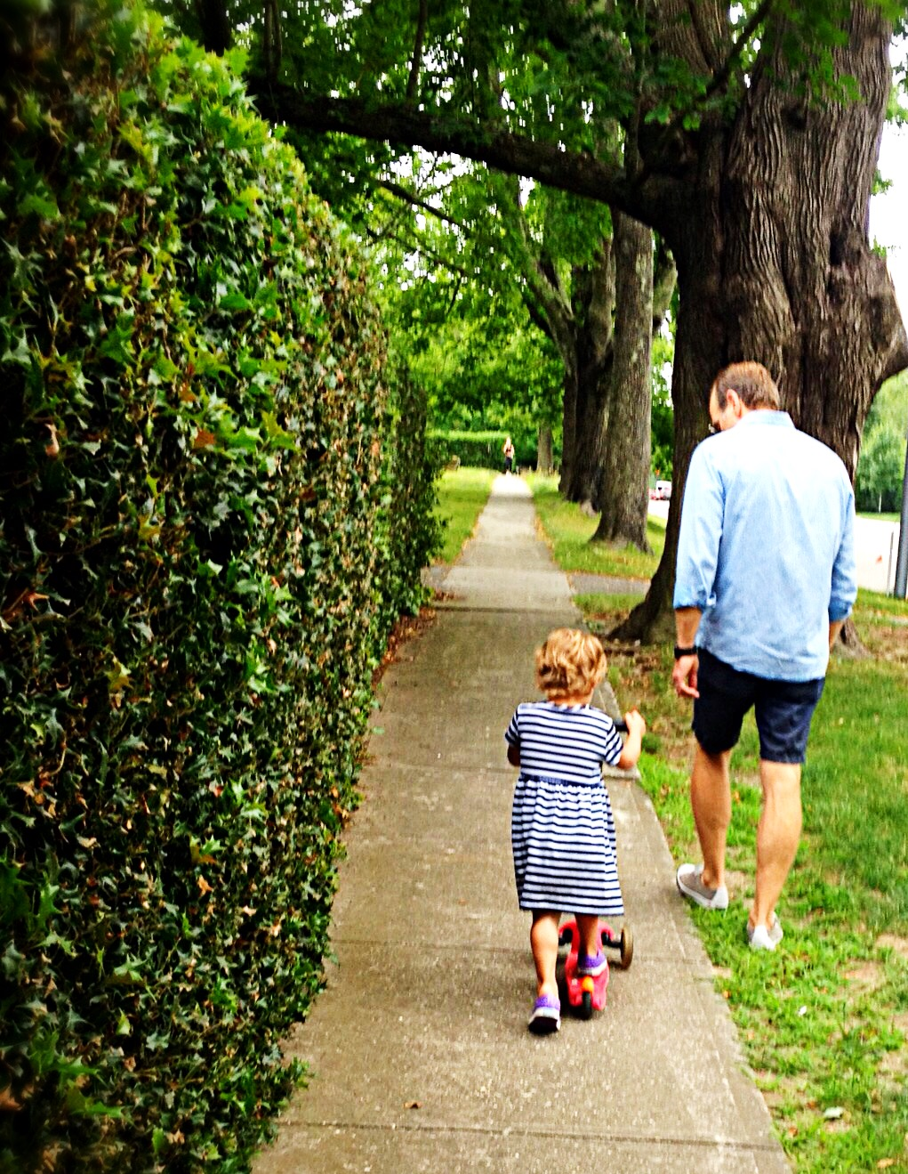 Photo of father and daughter enjoying a walk in Bridgehampton.