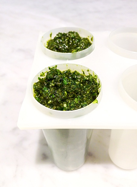 pesto portioned in popsicle mold