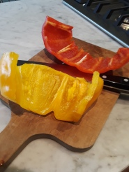 cleaning and chopping sweet peppers